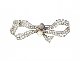 Antique Edwardian Diamond and Natural Pearl Bow Brooch in Platinum