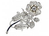 Retro Diamond, Sapphire, and Seed Pearl Flower Brooch in Platinum