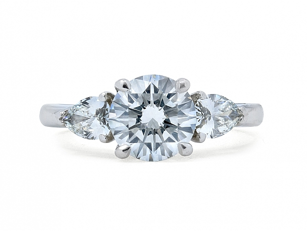 Diamond Solitaire Ring, 1.42 carat H/SI-1 with Pear-shape Diamond Shoulders, in Platinum